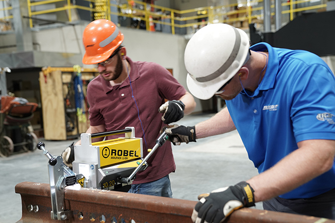 Engineer II Caleb Rogers, left, and Senior Engineer II Zach Dombrow test rail drills. BNSF's Strategic Sourcing Department sent several drills for testing and comparison.