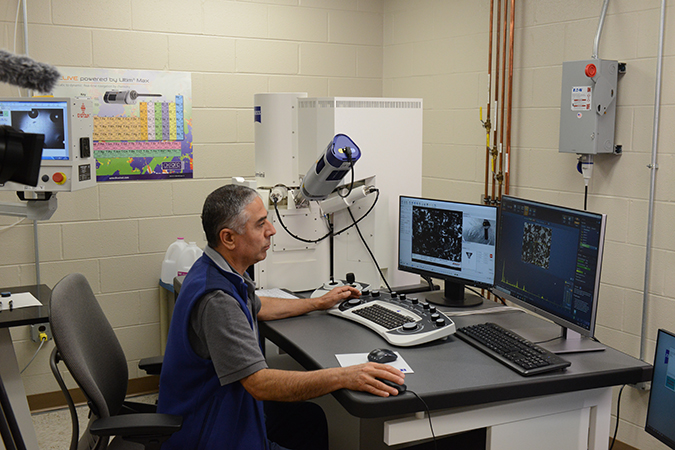 Senior Engineer I Huseyin Guzel performs chemical analysis of residue found in traction motors using a Scanning Electron Microscope (SEM)/Energy Dispersive Spectroscopy (EDS).