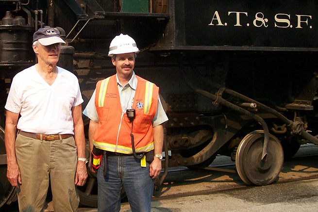 Director/actor Clint Eastwood, left, was on location for filming of The Changeling. Bob Brendza, now general director, Network Control Systems for BNSF, assisted in the operating plan.